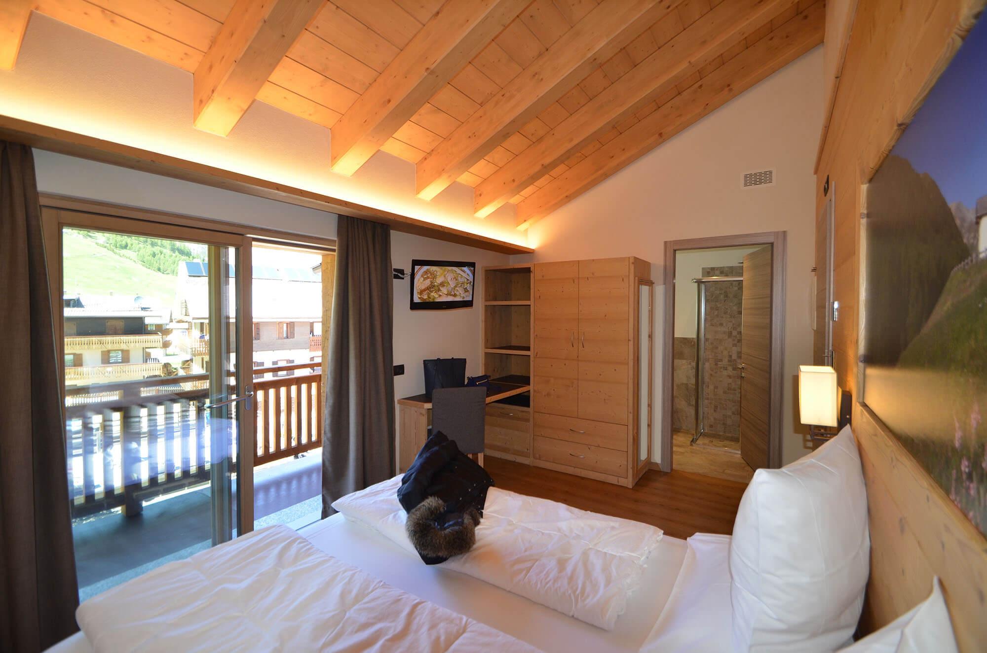 Molto pi di una stanza d 39 albergo hotel le alpi livigno for Aggiungendo una stanza al garage
