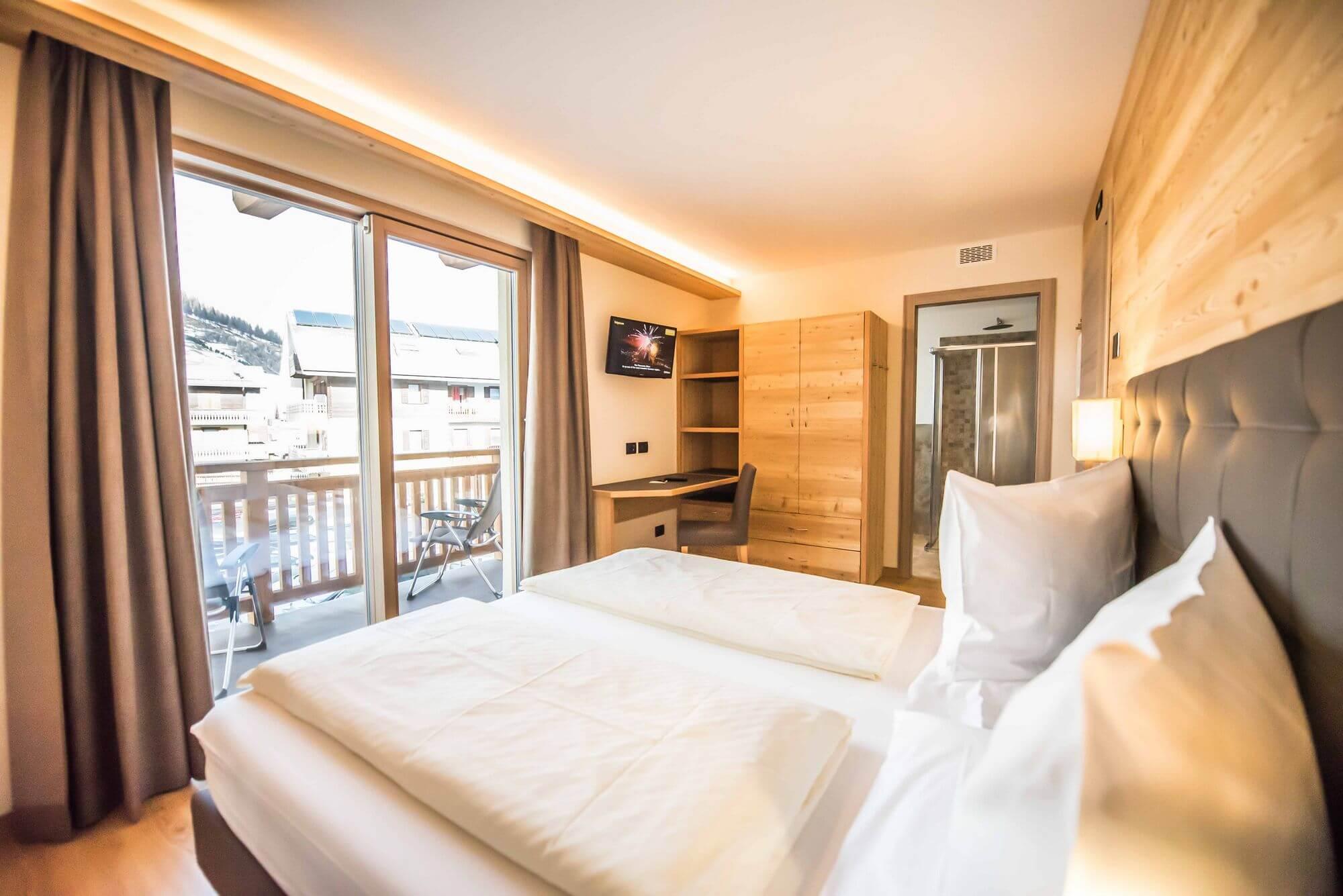 Molto pi di una stanza d 39 albergo hotel le alpi livigno for Camere di montagna